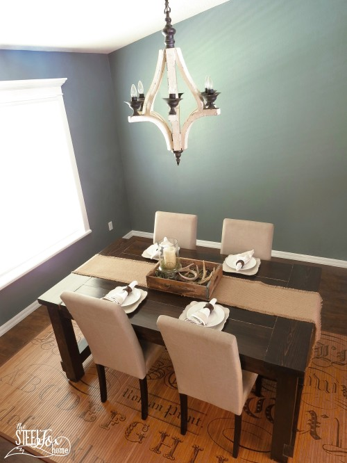 8- farmhouse fixer upper dining room renovation remodel reveal table deer antler centerpiece patents vintage antique barnwood before and after Chippy white wood chandelier the steel fox